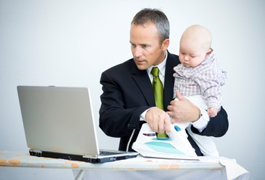 father and baby at computer